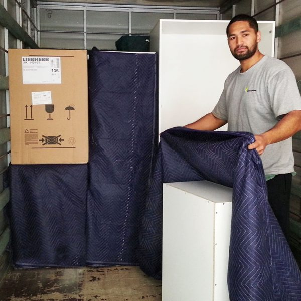 Whangarei furniture removals man wrapping furniture
